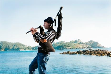 Galician piper Carlos Nunez at Cies Islands, Vigo, Spain